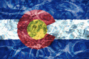 Colorado flag graphic under water
